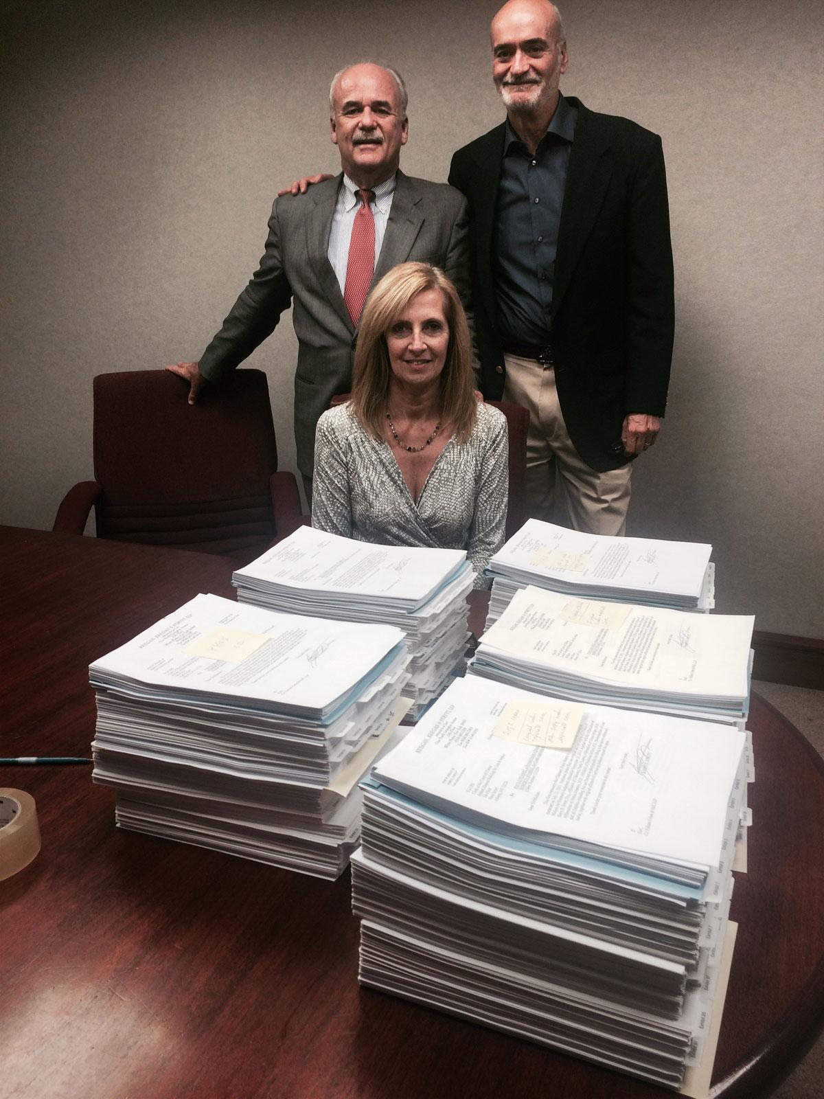 White Plains personal injury lawyers, John Keegan and Barry Strutt with their legal assistant, Lisa Logel